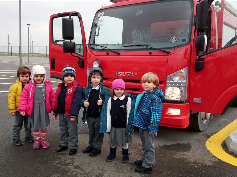 Our KG 1 students getting to know a fire engine